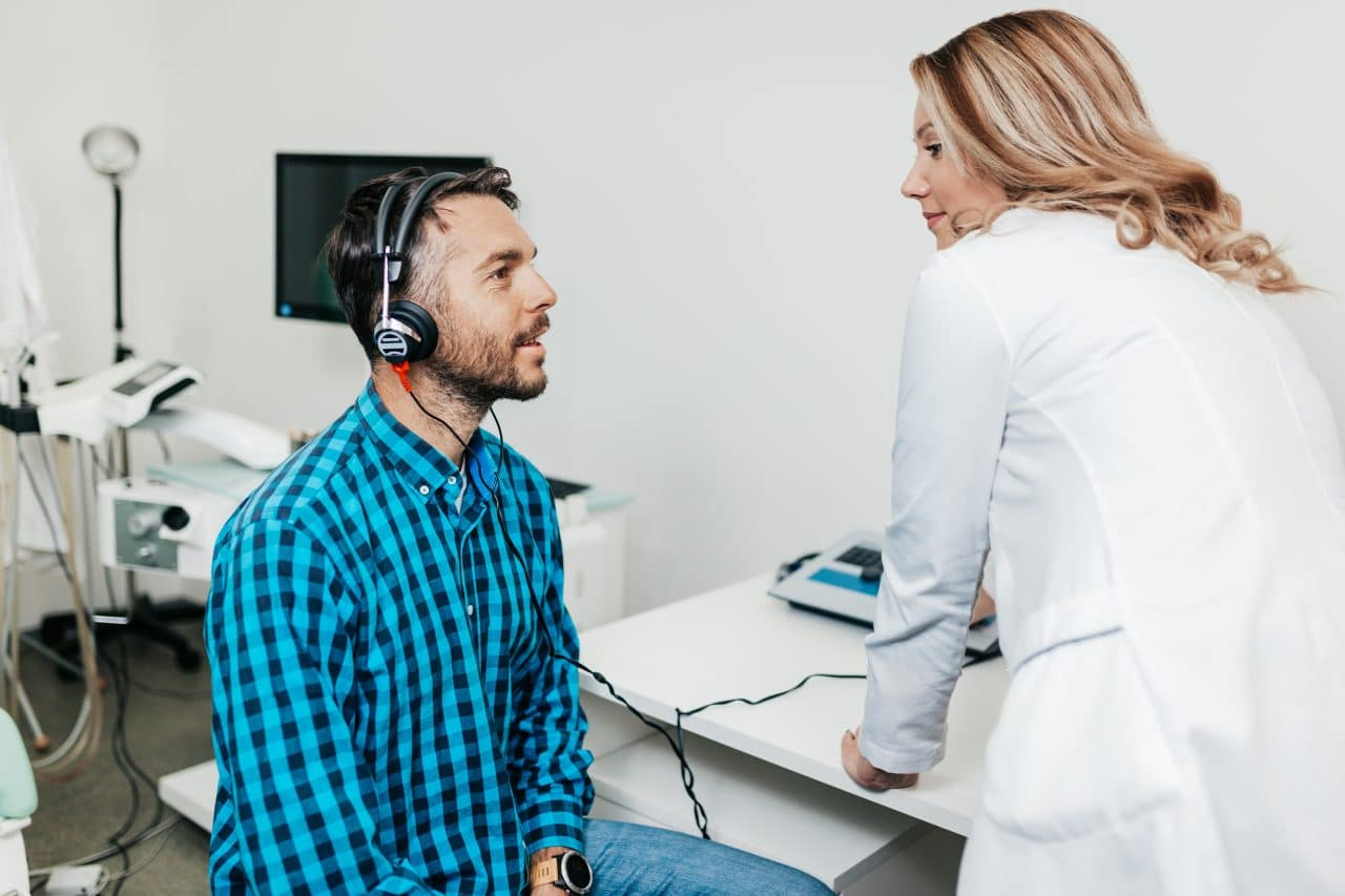 Middle-aged man getting a hearing test.